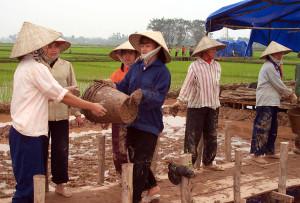 Vietnamese women working. From Wikimedia Commons. Public Domain.  Photo by Linda D. Kozaryn.